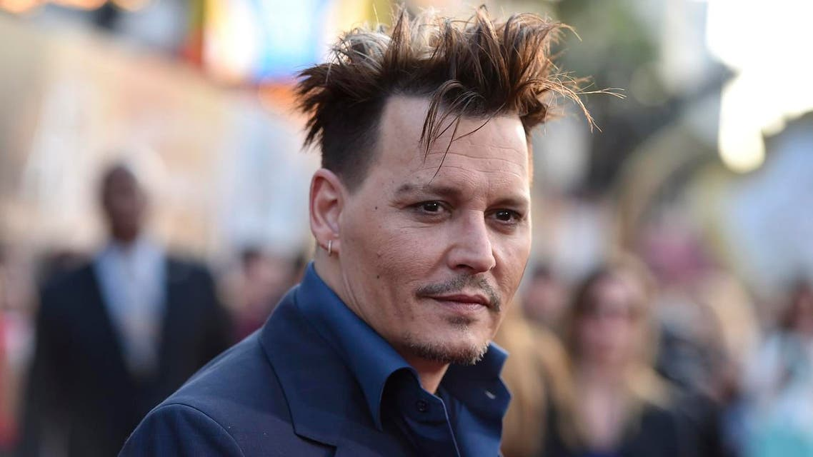 """Johnny Depp arrives at the premiere of """"Alice Through the Looking Glass"""" at the El Capitan Theatre in Los Angeles. (AP)"""