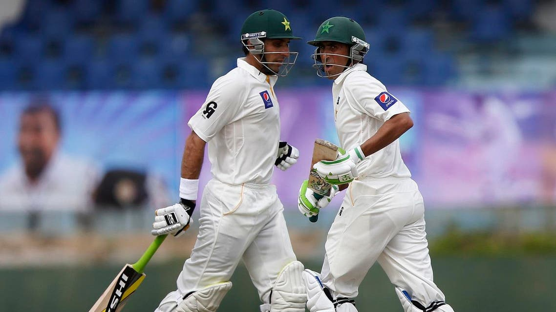 Pakistan's captain Misbah-ul-Haq (L) and Younis Khan run between wickets during the first day of their first test cricket match against Sri Lanka in Galle August 6, 2014.REUTERS
