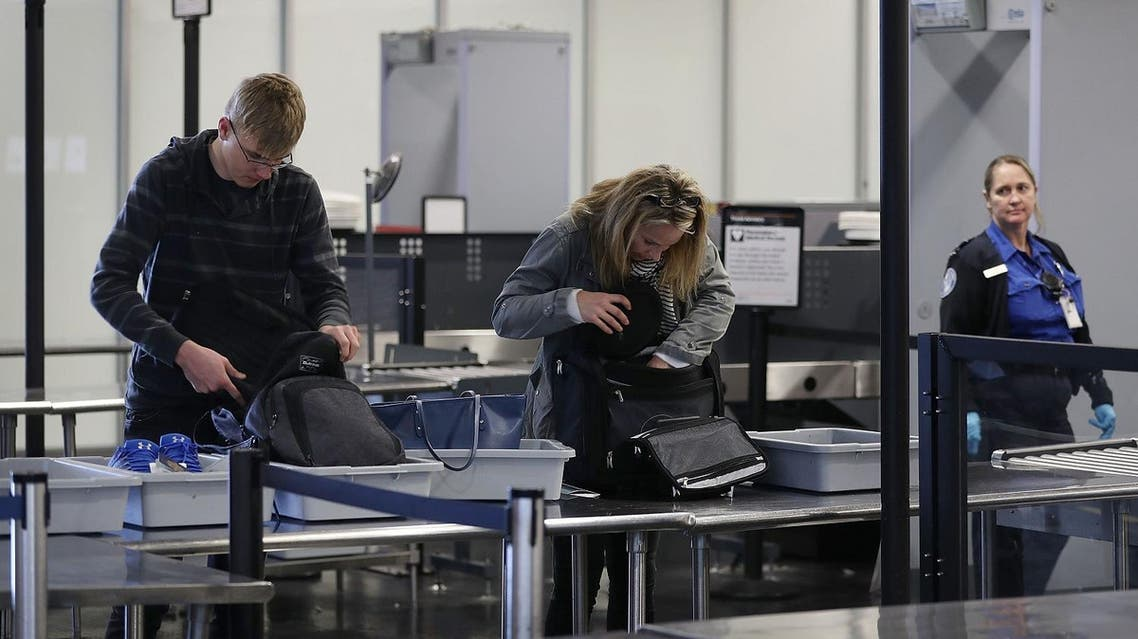 FORT LAUDERDALE, FL - MARCH 14: Travelers go through the TSA security checkpoint as Rep. Debbie Wasserman Schultz (D-FL) addressed the media about, 'President Trump's budget crisis', at the Fort Lauderdale-Hollywood International airport on March 14, 2017 in Fort Lauderdale, Florida. The congresswoman criticized the proposed cuts to the TSA, FEMA, and NOAA as well as the changes to the Affordable Care Act. Joe Raedle/Getty Images/AFP