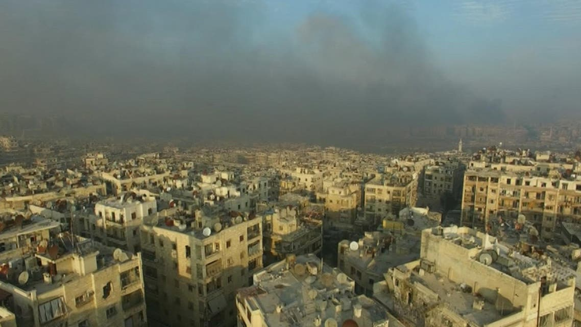 A still image from video taken December 12, 2016 of a general view of smoke rising over bomb damaged eastern Aleppo, Syria. Video released December 12, 2016. (Reuters)