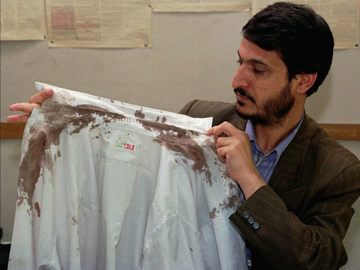Heshmatollah Tabarzadi, president of the Islamic Students' Association, shows his blood-stained shirt he was wearing when a dozen of militants backed by hard-liners burst into the paper's office his group used to publish, and beat him with a heavy cable in Tehran on Thursday, April 30, 1998. In August, President Mohammad Khatami, a moderate cleric, took office and began remaking the political scene. So far, his greatest achievement has been to lift restrictions on the press, cinema and the arts, breathing new life into Iran s cultural life. Monday, May 18, 1998. (AP Photo/Kamran Jebreili)