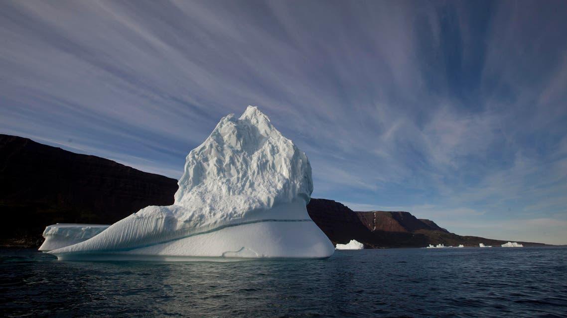 file photo, an iceberg floats in the sea near Qeqertarsuaq, Disko Island, Greenland. AP