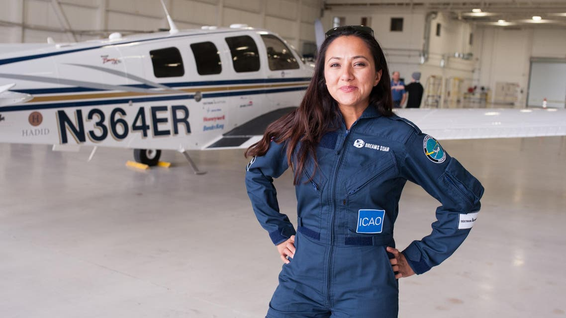Shaesta Waiz, Afghanistan's first female certified civilian pilot and a recent graduate of Embry-Riddle Aeronautical University, poses after arriving in Montreal, Canada, May 15, 2017 on the third leg of her round-the-world solo flight. (AFP)