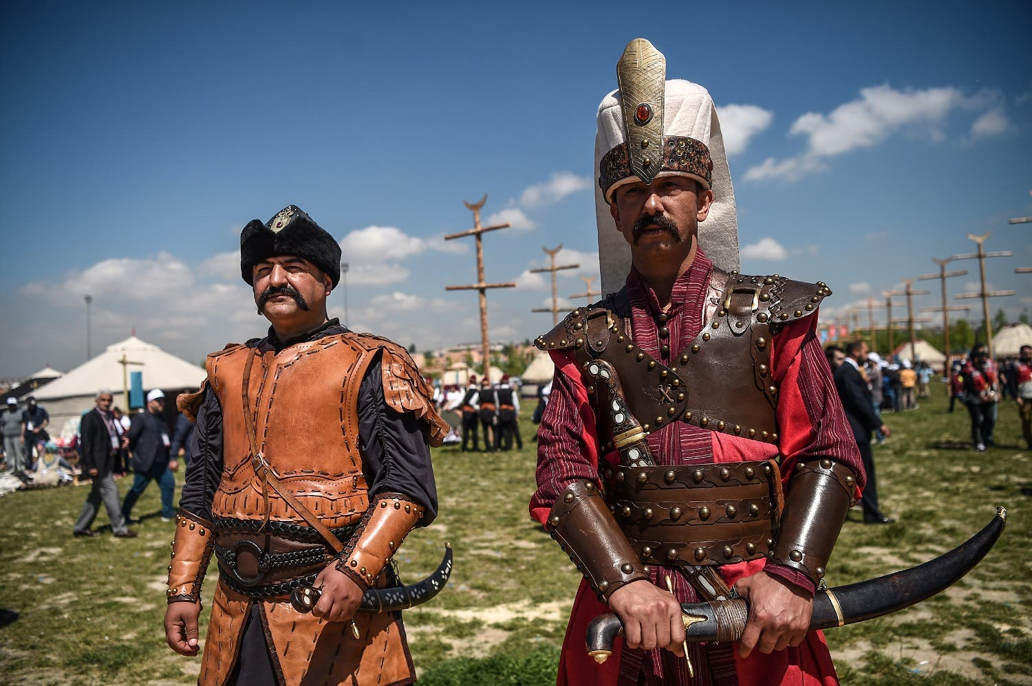 Men wearing ottoman clothes pose on May 11, 2017, during an oil wrestling tournament at part of Ethnosports Culture Festival in Istanbul. (AFP)