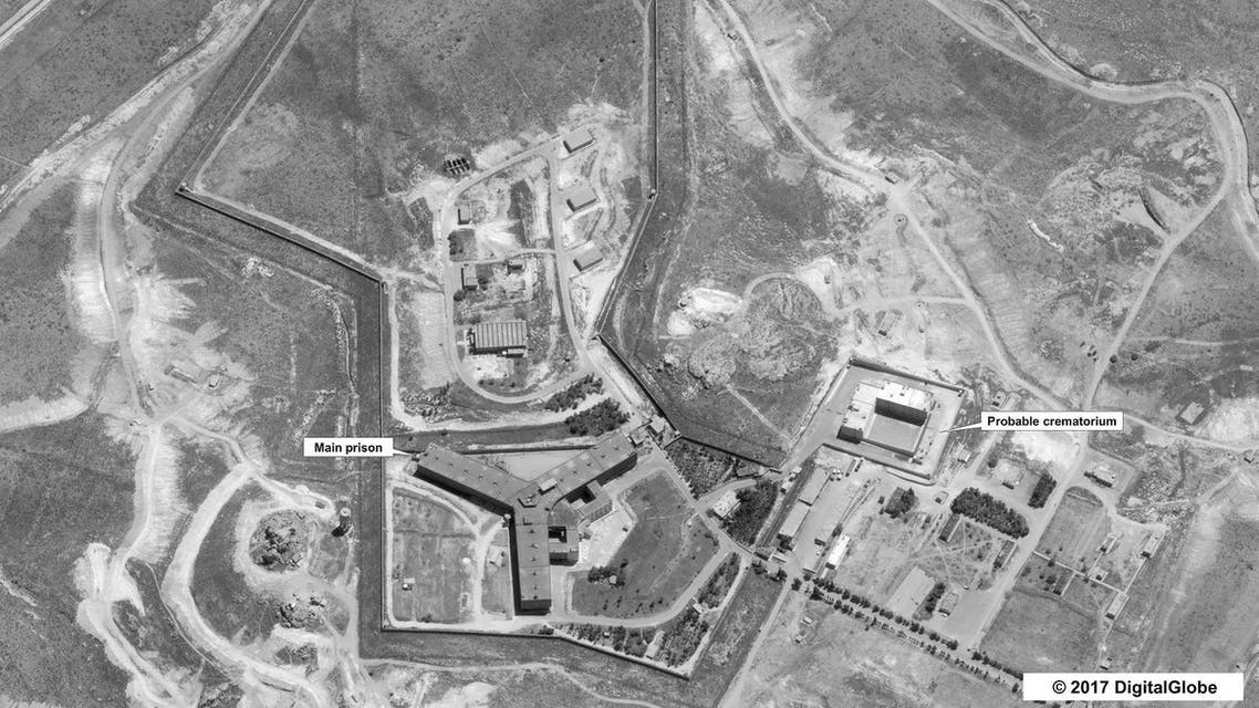 (FILES) A handout satellite image dated April 18, 2017 courtesy of DigitalGlobe and released May 15, 2017 by the US Department of State shows the Saydnaya prison, one of Syria's largest detention centres, located 30 kilometres (18 miles) north of Damascus. The United States on May 15, 2017 accused Syria of building a prison crematorium to destroy the remains of thousands of murdered detainees, putting pressure on Russia to rein in its ally. Warning Moscow it should not turn a blind eye to Bashar al-Assad's crimes, the State Department released satellite images that it said backed up reports of mass killings at the Syrian jail. (AFP)