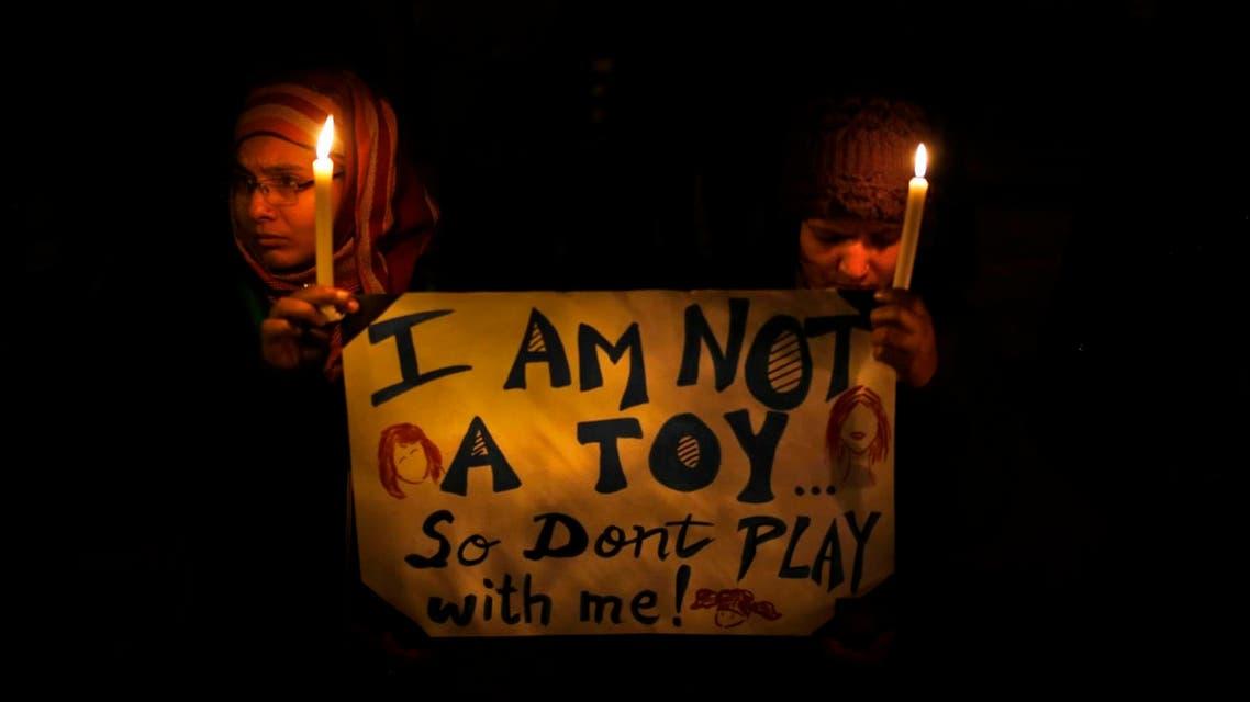 AP photo of people mourning gang rape victim