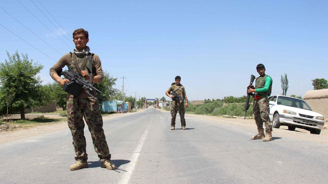 Afghan National Army (ANA) soldiers stand guard during a battle with Taliban in Kunduz provice, Afghanistan May 10, 2017