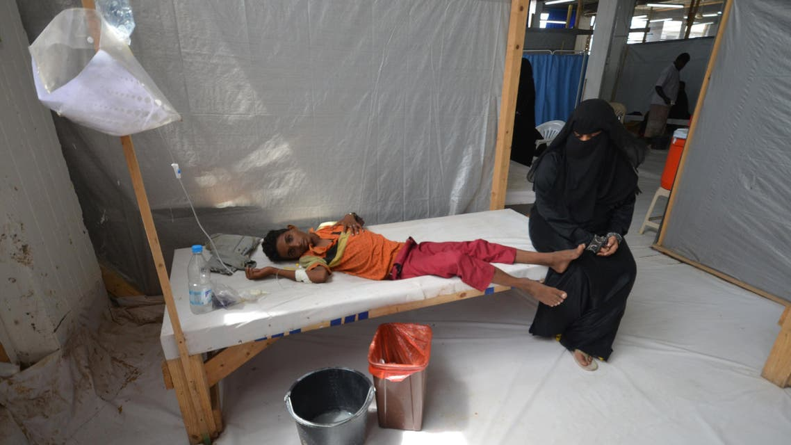 A woman sits next to her son who is infected with cholera at a hospital in the Red Sea port city of Hodeidah, Yemen May 14, 2017. (reuters)