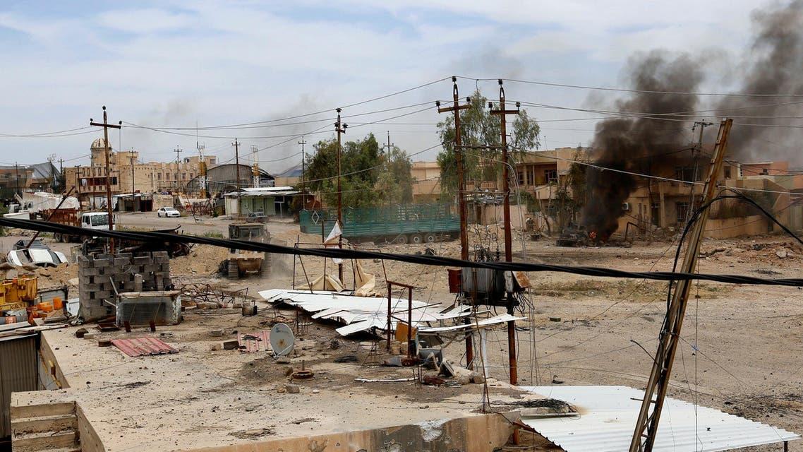 Smoke is seen after a suicide car bomb exploded during clashes between Iraqi forces and Islamic State militants in western Mosul, Iraq, May 16, 2017