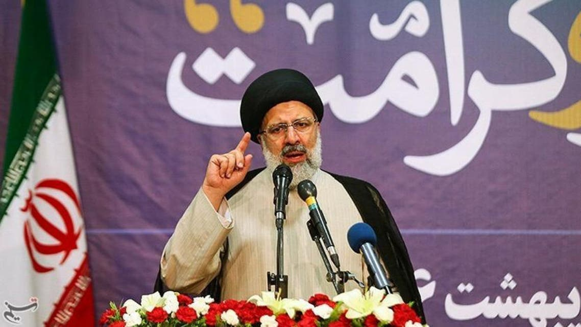 Ebrahim Raisi gestures in this undated handout photo provided by Tasnim News Agency on May 9, 2017.