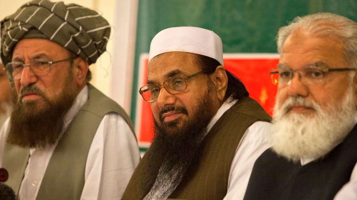 Hafiz Saeed, the head of Jamaat-ud-Dawa and founder of Lashkar-e-Taiba, (C) Jamaat-e-Islami, listen to a question during a news conference as Liaqat Baloch (R) leader of Jamand Mulana Sami-ul-Haq (L) chief of the Defence Council of Pakistan, looks on in Rawalpindi near Islamabad April 4, 2012. Reuters