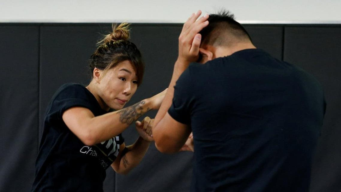 MMA fighter Angela Lee trains with her brother Christian Lee in Singapore. (Reuters)