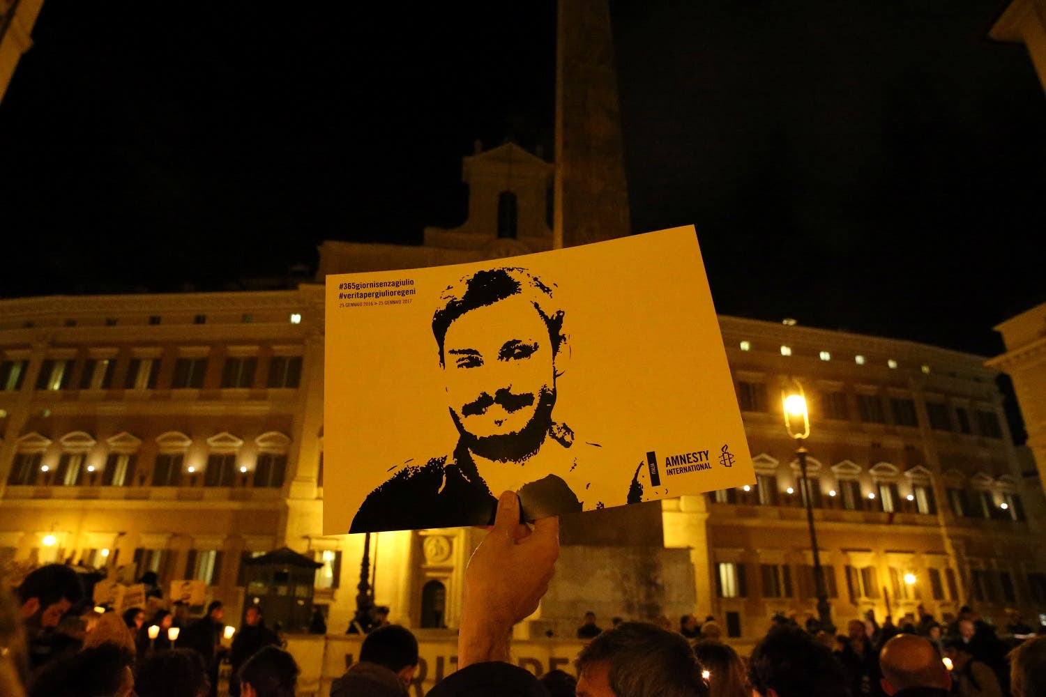 DATE IMPORTED: January 25, 2017 A man holds a placard during a vigil to commemorate Giulio Regeni, who was found murdered in Cairo a year ago, in downtown Rome, Italy January 25, 2017. (Reuters)