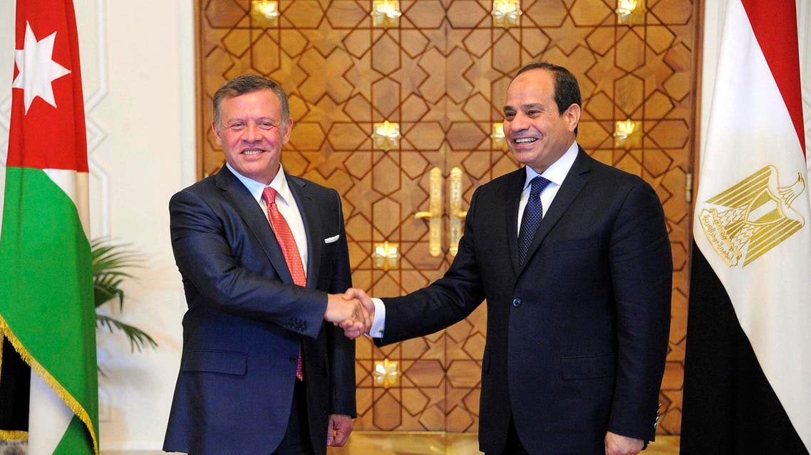 Egyptian President Abdel-Fattah al-Sisi, right, shakes hands with Jordan's King Abdullah II, in Cairo, Egypt, Wednesday, May 17, 2017. (AP)