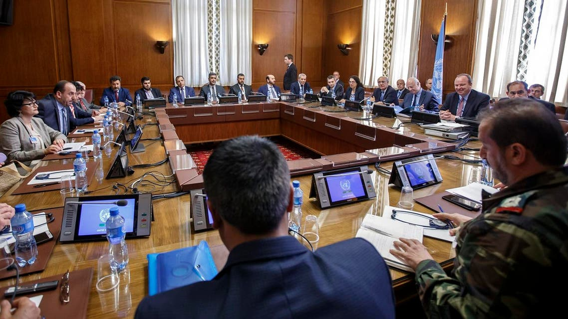 Syria's main opposition High Negotiations Committee (HNC) leader Nasr al-Hariri (2ndL) and UN Special Envoy of the Secretary-General for Syria Staffan de Mistura (3rdR) take part in a new round of Syria peace talks on May 16, 2017 at the United Nations Offices in Geneva. (AFP)
