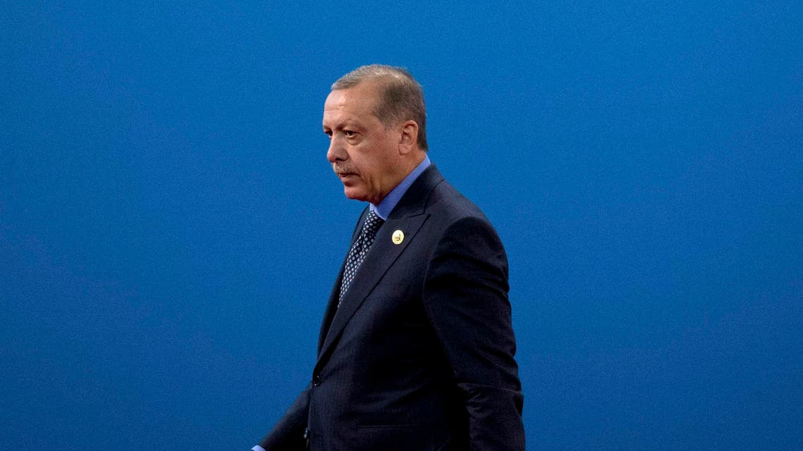 Turkey's President Recep Tayyip Erdogan leaves the stage after speaking during the opening ceremony of the Belt and Road Forum at the China National Convention Center (CNCC) in Beijing, Sunday, May 14, 2017. (AP)