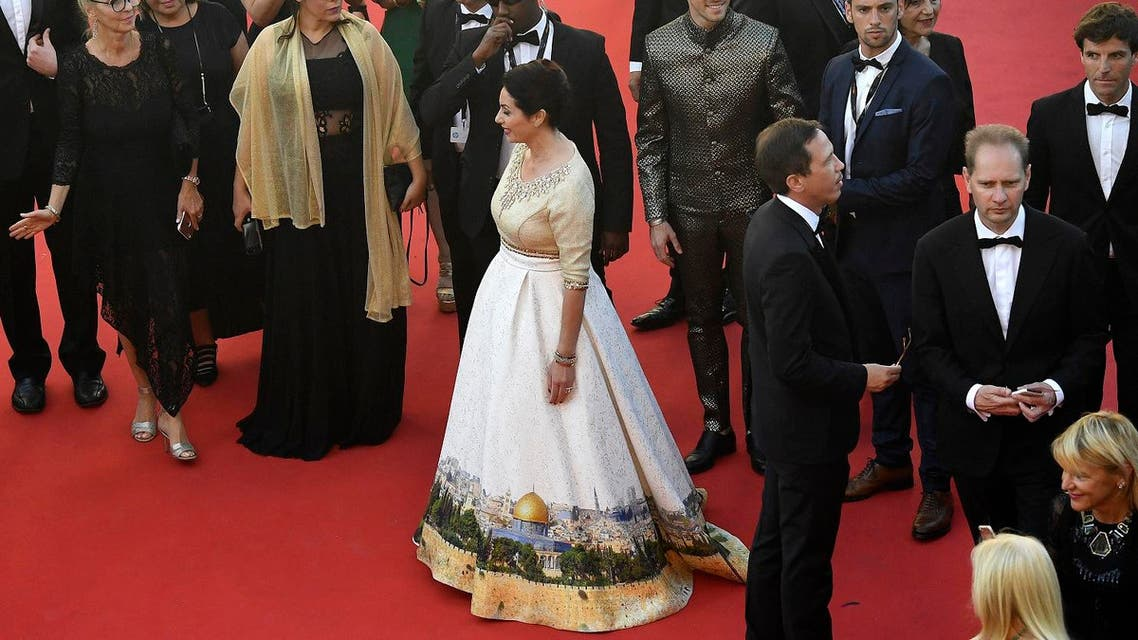 Israeli Culture Minister Miri Regev wearing a dress featuring the old city of Jerusalem arrives on May 17, 2017 for the screening of the film 'Ismael's Ghosts' (Les Fantomes d'Ismael) during the opening ceremony of the 70th edition of the Cannes Film Festival. (AFP)