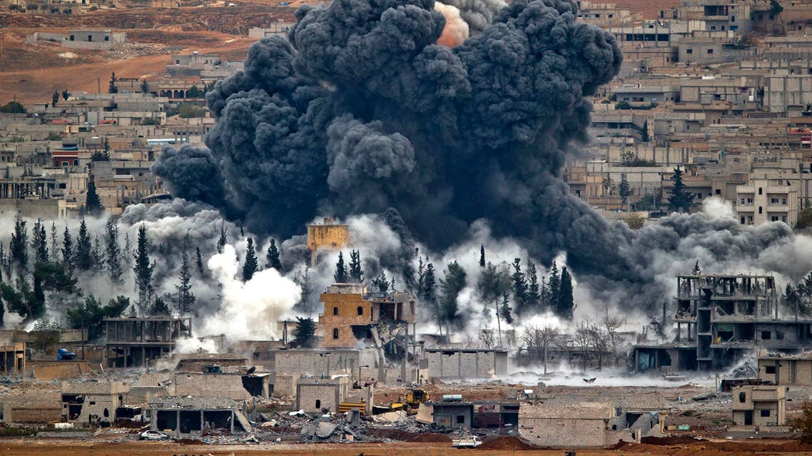Smoke rises from the Syrian city of Kobani, following an airstrike by the US led coalition, seen from a hilltop outside Suruc, on the Turkey-Syria border Monday, Nov. 17, 2014. (AP)