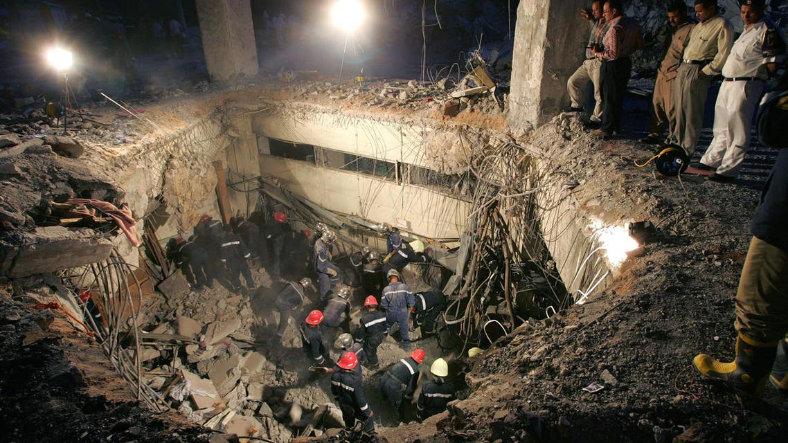 Egyptian authorities observe the ongoing excavation in the ground floor of the Hilton hotel in Taba on the Red Sea coast of Egypt's Sinai desert 10 October 2004. AFP