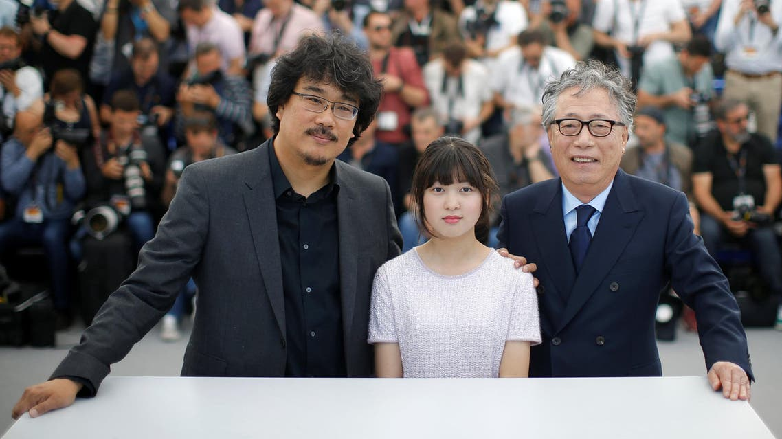 Director Bong Joon-ho and cast member, Seo-Hyeon Ahn and Hee-Bong Byun pose. Reuters