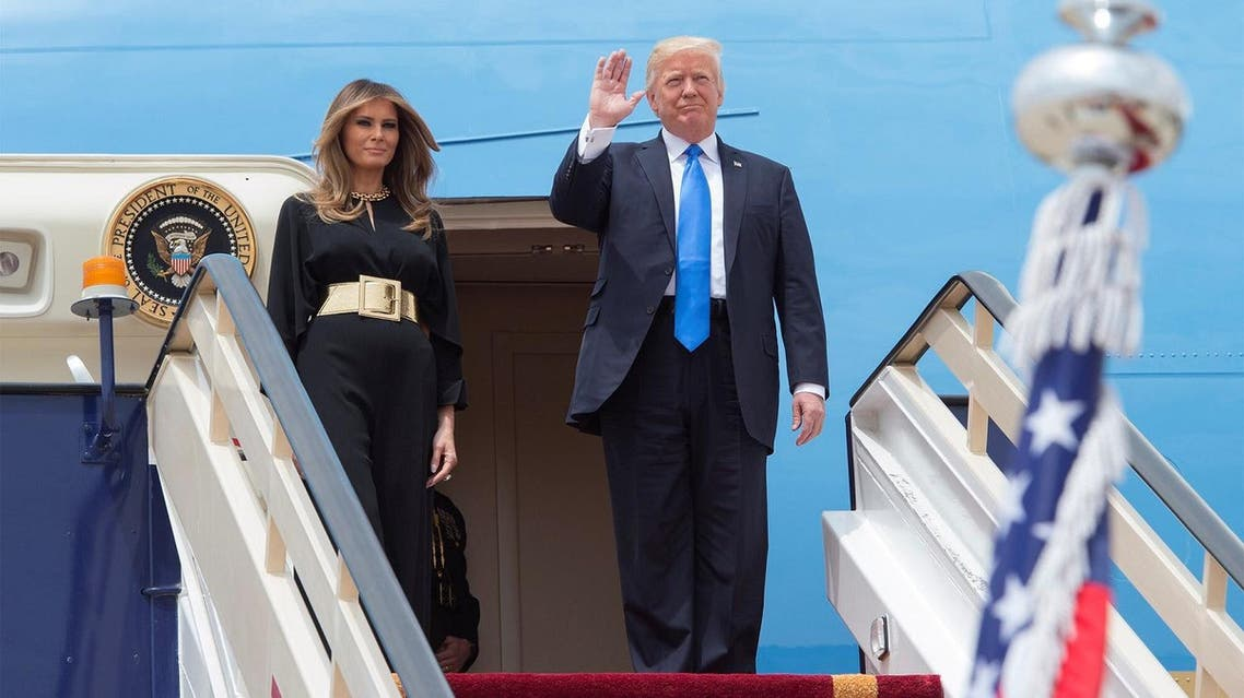 US President Donald Trump and first lady Melania Trump wave as they arrive in Riyadh, Saudi Arabia, on May 20, 2017. (Reuters)