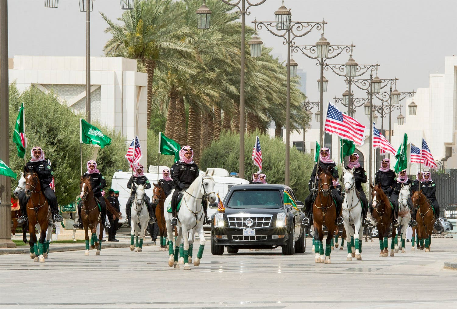 As the American president's car entered the Royal Court gate, it was accompanied by Saudi cavalryman wearing the official Saudi dress riding original Arabian horses. (Supplied)