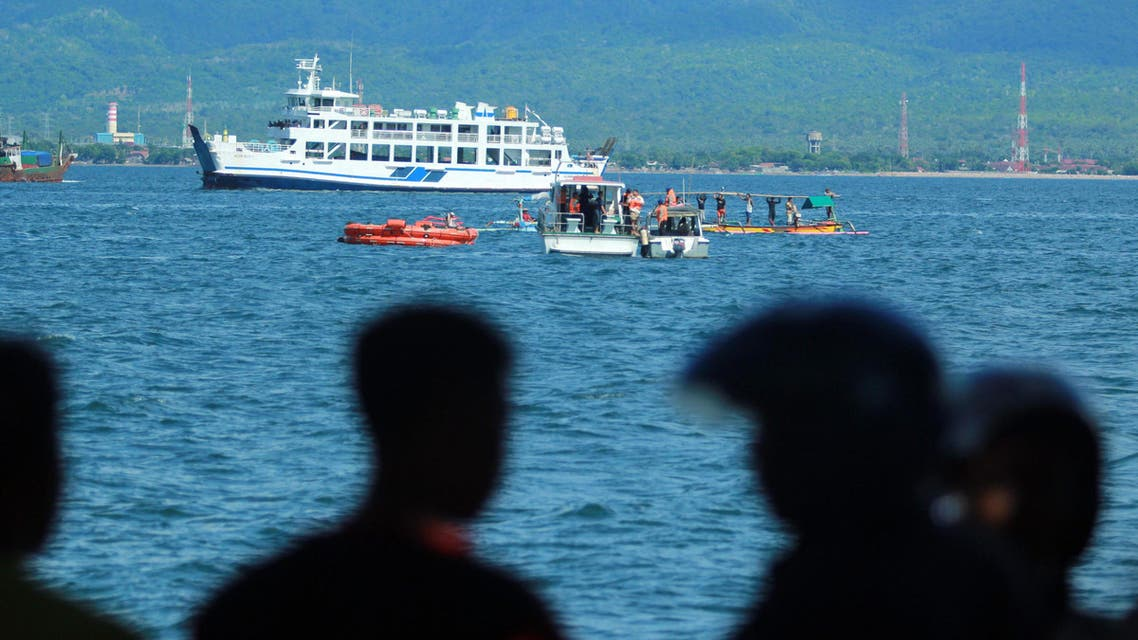 Residents watch as rescuers search for survivors at the site where a ferry sank off Banyuwangi, East Java, Indonesia, Friday, March 4, 2016. (AP)