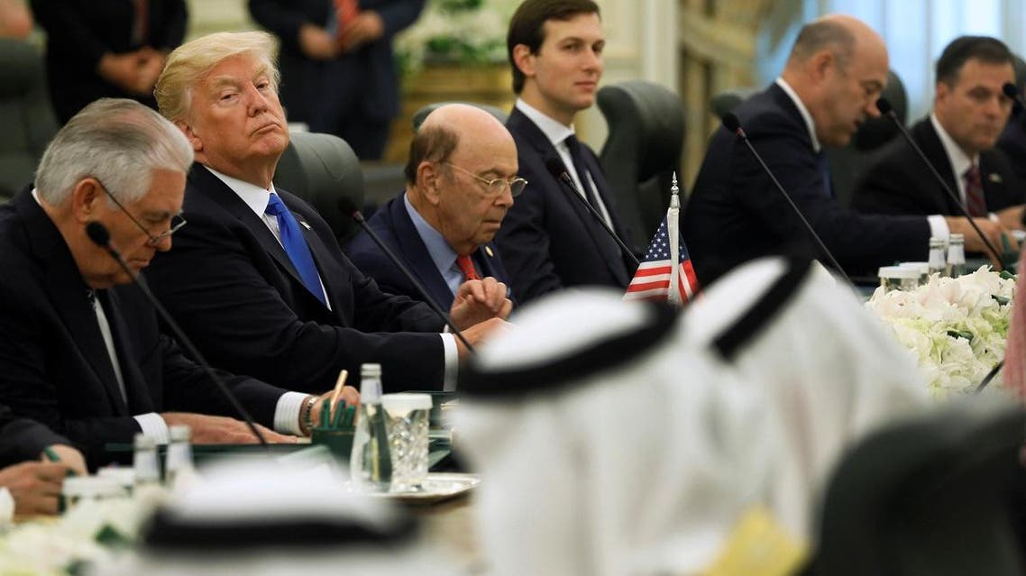 Trump and the U.S. delegation sit down to meet with Saudi Arabia's King Salman and his delegation at the Royal Court in Riyadh. (Reuters)