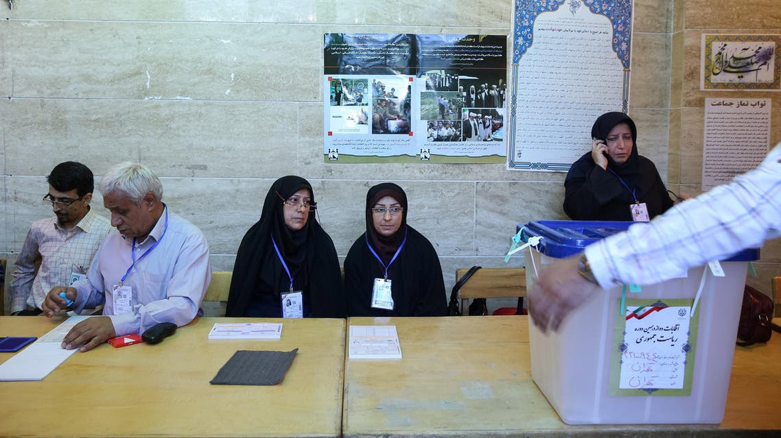 Iranian employees prepare a ballot box during the presidential election in Tehran, Iran, May 19, 2017.