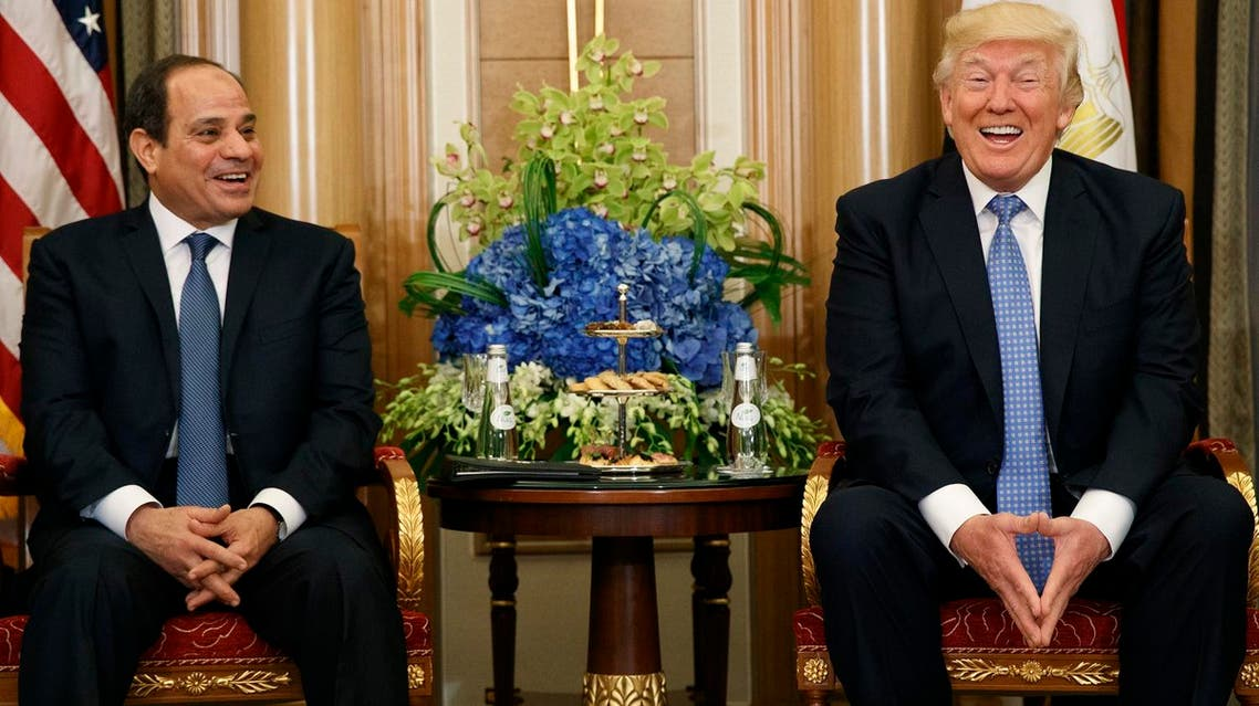 US President Donald Trump and Egyptian President Abdel Fattah al-Sisi share a laugh during a bilateral meeting on Sunday, May 21, 2017, in Riyadh. (AP)