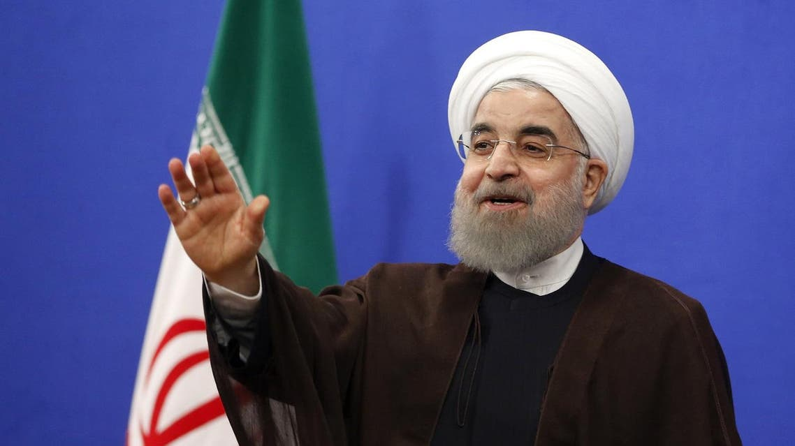 """Newly re-elected Iranian President Hassan Rouhani gestures during a televised speech in the capital Tehran on May 20, 2017. Iranians have chosen the """"path of engagement with the world"""" and rejected extremism, President Hassan Rouhani said following his resounding re-election victory. AFP"""
