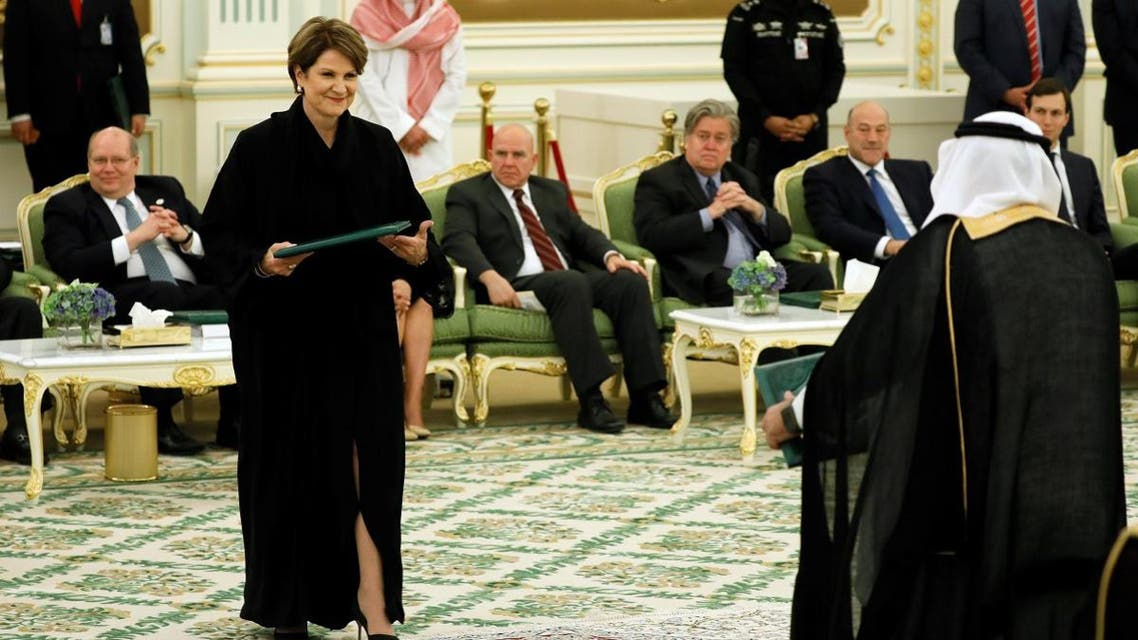 Lockheed Martin Chairman and CEO Marillyn Hewson (L) exchanges agreements with a Saudi official after a signing ceremony between Saudi Arabia's King Salman bin Abdulaziz Al Saud and U.S. President Donald Trump at the Royal Court in Riyadh. (Reuters)
