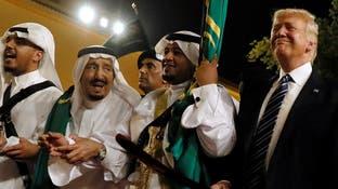 بالصور.. الملك سلمان وترمب يؤديان العرضة