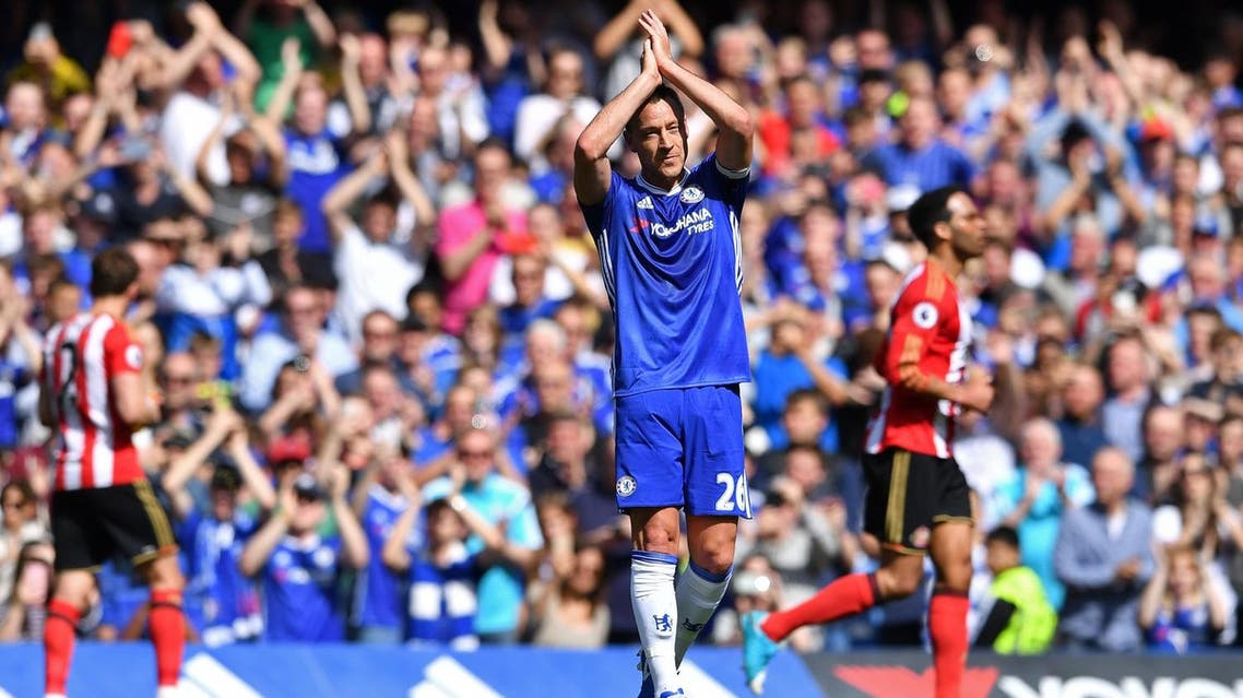 Chelsea's English defender John Terry gestures to the crowd as he is substituted off in the 26th minute during the English Premier League football match between Chelsea and Sunderland at Stamford Bridge in London on May 21, 2017. Terry will be leaving the club has been associated with for 22 years at the end of the season. (AFP)