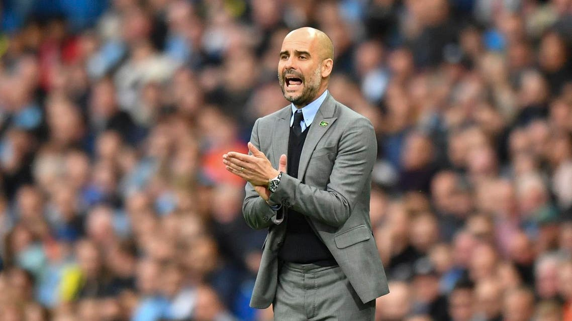 Manchester City's Spanish manager Pep Guardiola gestures on the touchline during the English Premier League football match between Manchester City and West Bromwich Albion at the Etihad Stadium in Manchester, north west England, on May 16, 2017. (AFP)
