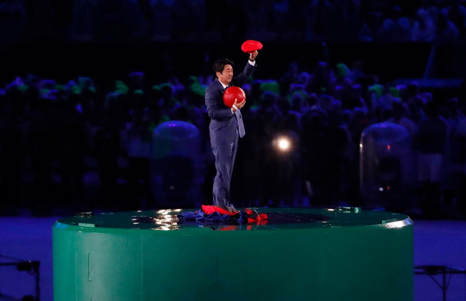 Japan's Prime Minister Shinzo Abe waves during the closing ceremony for the Summer Olympics in Rio de Janeiro, Brazil, Sunday, Aug. 21, 2016. (AP)