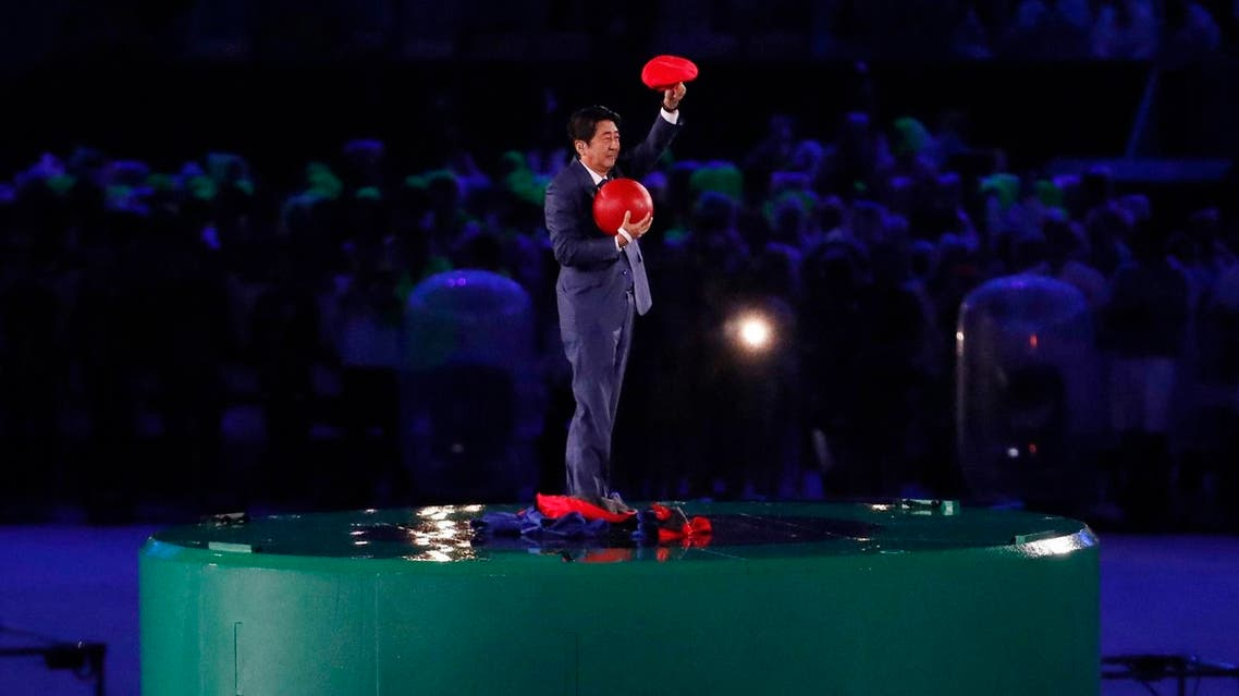 Japan's Prime Minister Shinzo Abe waves during the closing ceremony for the Summer Olympics in Rio de Janeiro, Brazil, Sunday, Aug. 21, 2016. Tokyo will host the next Summer Games, in 2020. (AP)