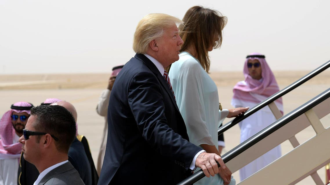 US President Donald Trump and First Lady Melania Trump make their way to board Air Force One in Riyadh as they head to Israel on May 22, 2017.