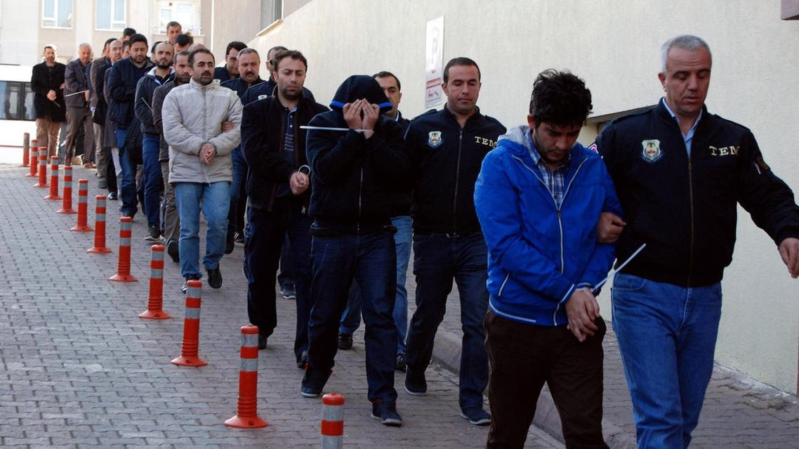 This image obtained from Dogan News Agency (DHA) shows Turkish police officers escorting people after their arrest for alleged links with US-based Muslim cleric Fethullah Gulen on April 26, 2017. (AFP)