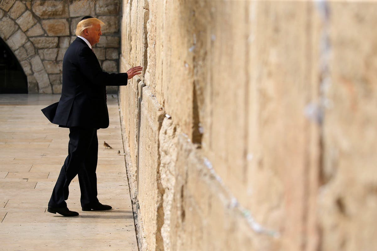 Trump leaves a note at the Western Wall in Jerusalem. (Reuters)