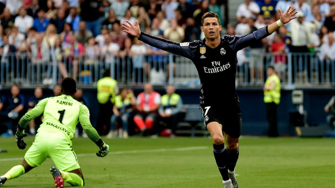 Real Madrid ended their five-year wait for the La Liga title on Sunday as Cristiano Ronaldo and Karim Benzema scored in a 2-0 win at Malaga. (AFP)