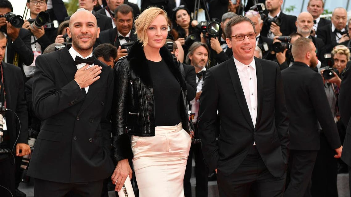 The Un Certain Regard jury (From L) Egyptian director Mohamed Diab, US actress Uma Thurman and French actor Reda Kateb arrive on May 18, 2017 at the 70th edition of the Cannes Film Festival. (AFP)