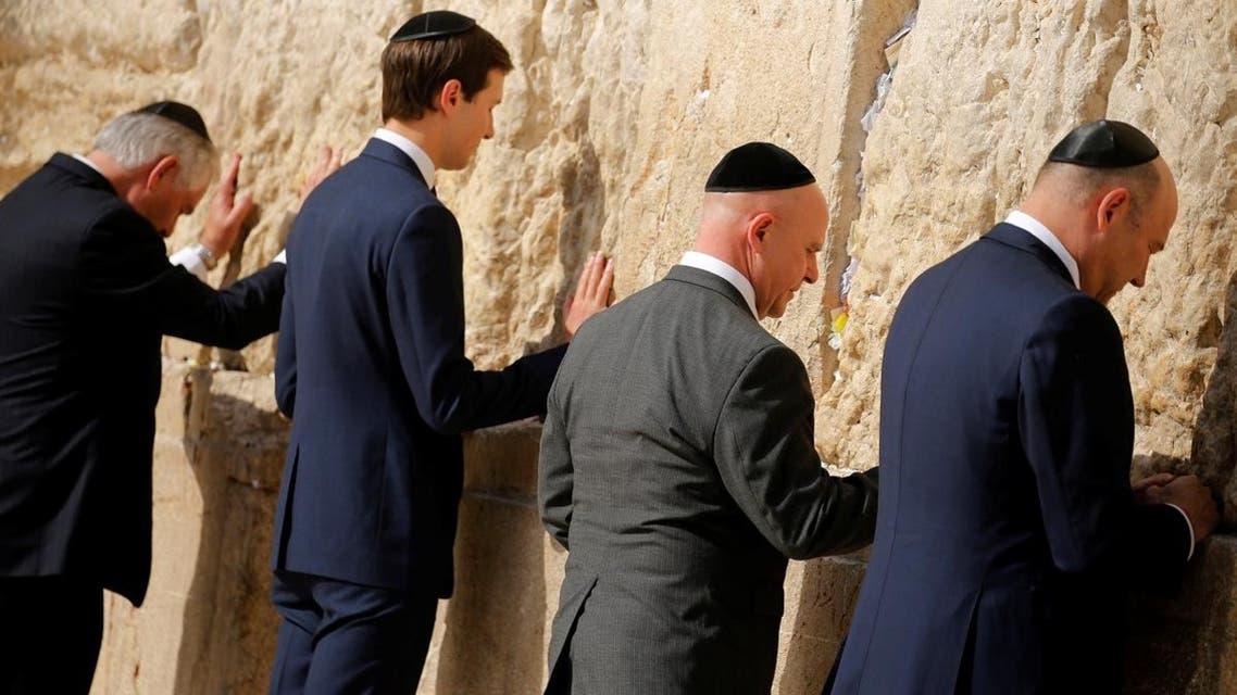Tillerson, Kushner, McMaster and Cohn leave notes at the Western Wall in Jerusalem. (Reuters)