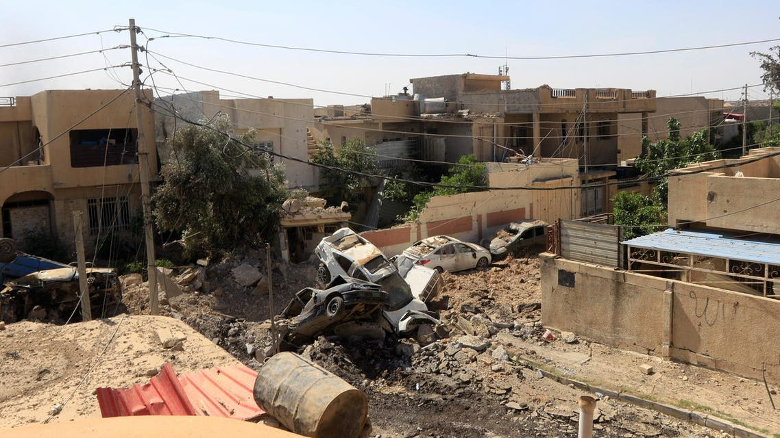 Cars destroyed in clashes are seen on a street during a battle between Iraqi forces and Islamic State militants in western Mosul, Iraq May 21, 2017