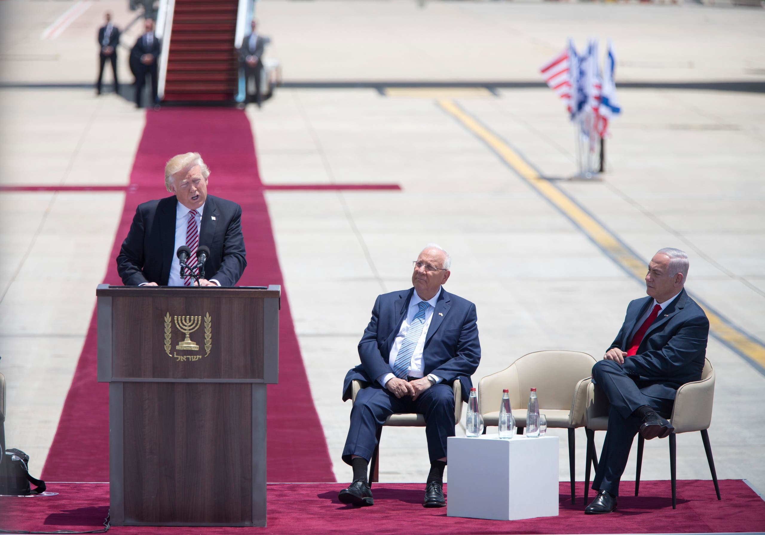 US President Donald Trump speaks during welcome ceremony in Tel Aviv, Monday, May 22,2017, accompanied by Israel's President Reuven Rivlin, center, and Prime Minister Benjamin Netanyahu. (AP