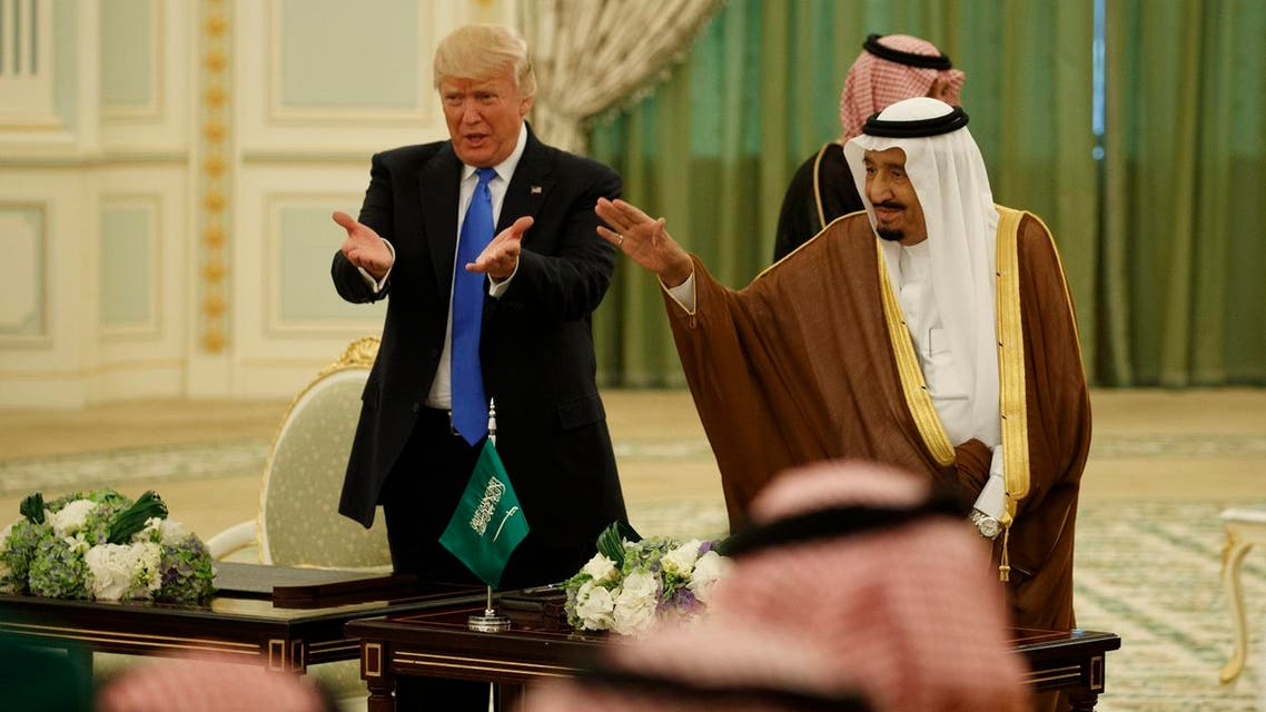 President Donald Trump and Saudi King Salam wave to the crowd during a signing ceremony at the Royal Court Palace, Saturday, May 20, 2017, in Riyadh. (AP)