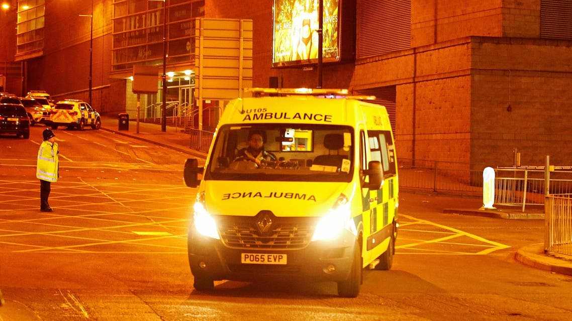 An ambulance drives away from the Manchester Arena, where U.S. singer Ariana Grande had been performing, in Manchester, northern England, Britain, May 23, 2017. (Reuters)