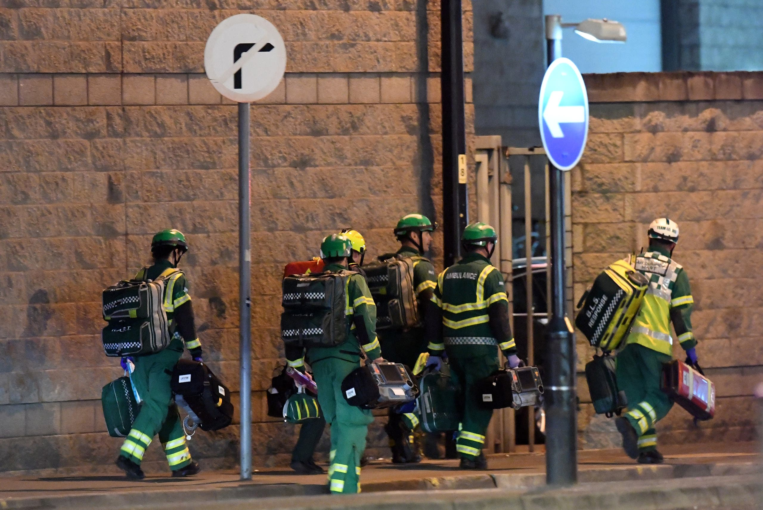 Medics deploy at the scene of a reported explosion during a concert in Manchester, England on May 23, 2017. (AFP)