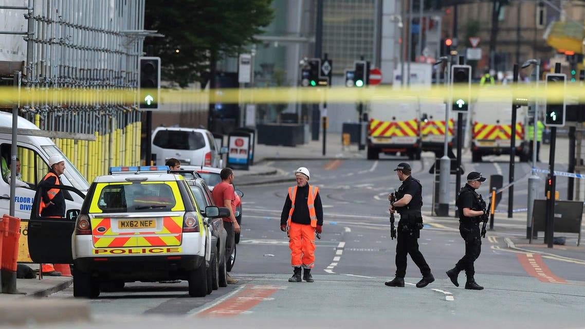 Police guard close to the Manchester Arena in Manchester, Britain, Tuesday May 23, 2017. (AP