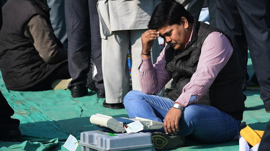 An Indian election official checks an Electronic Voting Machines (EVM) at a distribution center in Ghaziabad near the capital New Delhi on February 10, 2017. (AFP)